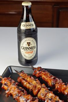 Grilled chicken skewers made with chicken thighs covered in a sticky, sweet, and tangy beer-spiked glaze.