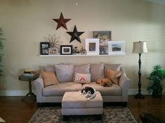 Our shelf inspired by a photo on Pinterest.  My dad built it for us :)  Dogs always have to be in the picture.  The stars and rod iron items are from Hobby Lobby.