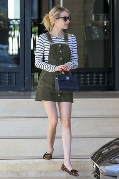Best dressed this week: 7 November. Striped long sleeved t-shirt+green dungaree dress+leopard-print flats with black bows+black handbag+sunglasses. Fall Casual Outfit 2016