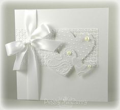 Whiter Shade of Pale Might try to add red or light pink bling/pearls on hearts. Like the white design also