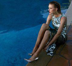 Posing next to a pool, Kelly Rohrbach models silver Altuzarra dress and Jimmy Choo heels