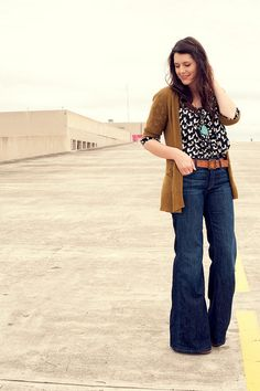 Trouser jeans, delicate top, and cardigan.  Cute look.