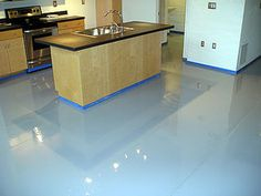 Concrete Kitchens - Low Maintenance Flooring For a High Maintenance World: Polished concrete can be a slick, sophisticated, modern look in an interior kitchen.