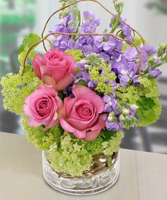 Smiles For You: This cheerful design of pink roses, purple stock and green hydrangeas is sure to put a smile on anyone's face! - Sarasota Florist - Beneva Flowers - Voted Best Florist Sarasota FL