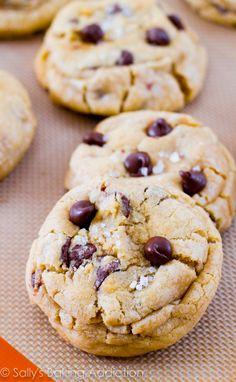 The ultimate sweet & salty treat! Thick and chewy chocolate chip cookies stuffed with gooey caramel and topped with sea salt. @sallybakeblog