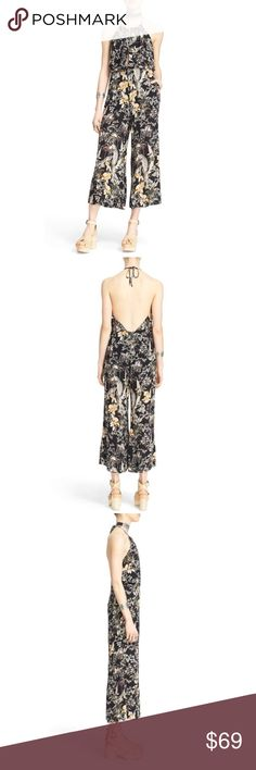 NWT Free People Twisted Halter Jumpsuit A halter-style neckline tops a bohemian-cool cropped jumpsuit cut from lightweight textured crepe. The sunshine-ready look is patterned with a vintage-inspired print of blossoming blooms and finished with a flirty exposed back.                                                              - Halter neck with tie closure  - Back zip closure  - Sleeveless  - 2 side slit pockets  - Front keyhole  - Cropped leg  - Allover print  100% rayon Free People Pants…