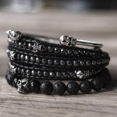 New bracelet stack, composed of a skull bangle, hematite leather wrap bracelet & lava stone sterling silver skull elastic bracelet