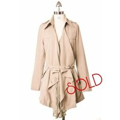 [SOLD] Chicwish Lace Ruffle Belted Tan Trench Coat Versatile, vintage-inspired belted trench coat, by Chicwish. Fabric feels incredibly soft and luxurious to touch.  Features: Detachable belt Detachable lace ruffle detail Two side pockets, with flaps that can be tucked in or out Shoulder lapels with buttons One button closure on the front (at waist height) 50% Cotton, 50% Polyester Machine washable  Size Small (Should fit S as well as XS sizes)  New without tags Chicwish Jackets & Coats
