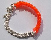 http://www.etsy.com/listing/95974536/gimpnlinks-bangles?ref=sr_gallery_37=_search_query=neon+jewelry_order=most_relevant_view_type=gallery_min=0_max=0_mh_hub=fashion_mh_eid=1038749238_mh_section=clusters_mh_cid=bright-jewelry_page=7_search_type=all_facet=