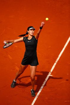 Ana Ivanovic Photos Photos - Ana Ivanovic of Serbia serves in her Women's Singles match against Donna Vekic of Croatia on day six of the 2015 French Open at Roland Garros on May 29, 2015 in Paris, France. - 2015 French Open - Day Six