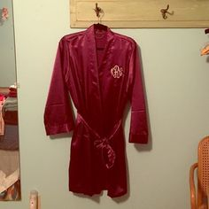 """Plum colored silk robe Worn once for getting ready wedding pictures. Beautiful deep purple/plum color. It even has pockets!!!! Monogrammed with the initials NCR. No damage at all. Perfect condition! Robe tie attached and inner tie which is really nice. (Shown in pics) I will measure if you need me to! I'm 5' 3"""", so you can see in the picture where it falls on me. Bundle for more discounts!  Intimates & Sleepwear Robes"""