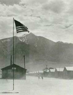 Japanese Internment Camps. Ironic that an American flag that symbolizes freedom is flying over an Interment camp