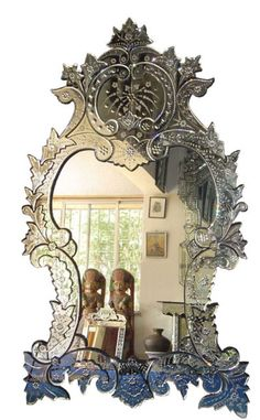 Mirrors from the early years, resembled picture frames & were embellished with elaborate gilding & carvings. Later, mirror frames went from being wood-only to other types of frames like plaster on a wire, which were called composition frames. Although nice looking, chipping of the plaster was a big problem.   ~Seen here: Antique Venetian Mirror~