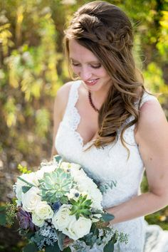 Loved it! Pinned it! A Blooming Envy Design! Wedding Bouquet made with Succulents, White Roses, Dusty Miller, Eucalyptus, Silver Brunia Berries & Blue Thistle. Photo by cjphotogallery.net
