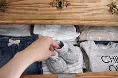 Homevialaura | preparing for a baby | nursery | neutral new born clothing | antique dresser