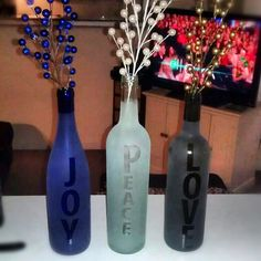 Joy, Peace, Love. Wine bottle craft! Made using sticker letters and glass frost spray!