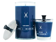 """These midnight blue candles are housed in iconic stainless steel and molded glass """"Barbicide"""" jars."""