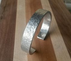 SIlvery hammered aluminum cuff bracelet by ReClassifiedTreasure