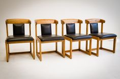 Wood and Vinyl Dining Chairs $395 - Chicago http://furnishly.com/catalog/product/view/id/1751/s/wood-and-vinyl-dining-chairs/