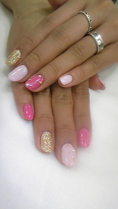Pink Nails with gold glitter and studs