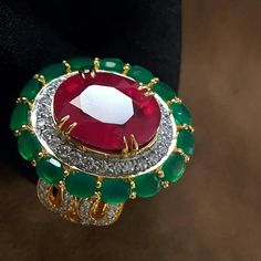 #iijs2017 Gold ring with diamonds emerald and ruby