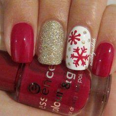 Manicure navideña copos rojo y blanco