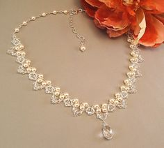 Bridal Necklace, Wedding Jewelry, Ivory Pearl and Crystal Necklace, Crystal Teardrop Necklace, Choice of White or Ivory Pearls Available. $130.00, via Etsy.