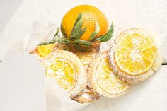 Delicious orange slice topped cookies recipe. Almond cookies topped with a sweetened thin slice of mandarin orange. Perfect with tea or as a cookie gift.