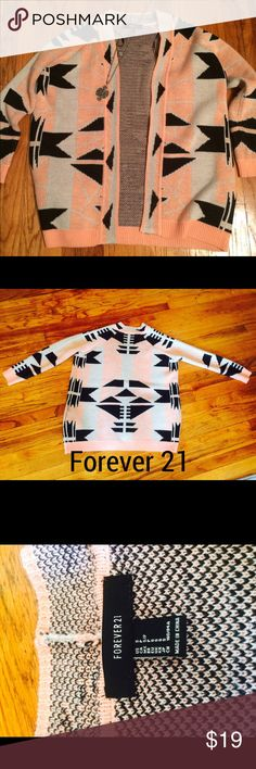 ⭐️ONE HOUR ONLY PRICE CUT🌟 Forever 21 Cardigan Forever 21 Aztec Cardigan, size small. Thick material, very warm in the winter. Loose fitting. Great for layering. Ideal to wear with leggings and tall boots. Smoke free home ✅Offers Accepted Below✅ 🚫TRADES🚫 Forever 21 Tops Tees - Long Sleeve