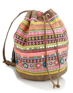 A party of a bag that is practically begging to travel and will work well as a gym tote long after the sun has set on summer. Drawstring purse via Accessorize