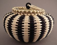 A beautiful basket, woven from brown ash and sweetgrass, by Jeremy Frey, a Passamaquoddy artist. Jeremy's work is extremely highly regarded among weavers and collectors and is held in several prestigious museum collections.