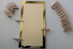 card with braille words and clothespins with contractions