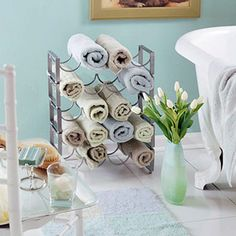 Love the wine rack as a towel holder! Tips for bathroom organization on a small space!