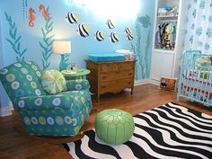 Love the mural and the coral curtains. I'm pretty sure the zebra rug shouldn't be in there though... Also, it doesn't *have* to be an ocean themed room, so long as there are octopuses somewhere :)