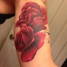 Two rose watercolor tattoos on arm for girls - red tattoos