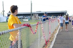 Linked together in survival.... As survivors registered this year they reiceived a paper chain link for each year of survival made by a troop of volunteer Girl Scouts.  When they completed their victory lap, survivors turned their chains back in and the links were joined together to form this massive chain.  #Relay For Life of Boardman, OH