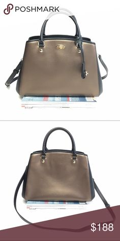 Coach Small Margot Carryall Gorgeous Coach bag that's perfect for fall. Straps are detachable. Can be carried by handle tops or worn crossbody. In excellent condition. Metallic crossgrain leather Inside zip, cell phone and multifunction pockets. Zip-top closure, fabric lining Handle with 3 3/4 drop Strap with 20 drop for shoulder or crossbody wear 13 3/4 (L) x 9 (H) x 6 1/4 (W) Coach Bags Crossbody Bags