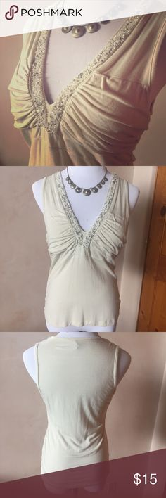 Sleeveless knit top with bead neckline Yuka brand knit tank with beaded neckline.  Good used condition - very minor pilling and one edge of bead could use some stitching as shown. No other flaws or stains. 92% rayon, 8% spandex. yuka Tops