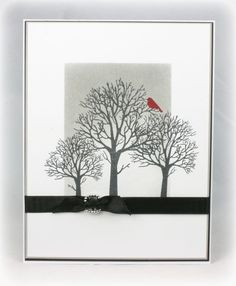 handmade card ... black and white with a pop of red ... clean and simple style ... three leafless tress in black against a white and gray  background ... one lone red bird .... black ribbon ties ina know ... luv the sophisticated feel of this card!!!