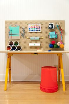 A children's arts  crafts station for under $50. Not a bad way to organize just about anything in our workroom, really...