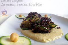 Riso venere con zucchine al curry su crema di ceci