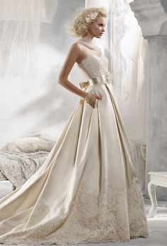 Get inspired: A beautiful Alvina Valenta wedding dress. Look at those elegant folds!