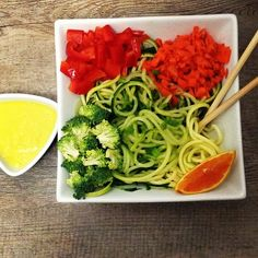 Cucumber and zucchini noodles with spicy lemon/orange ginger dressing.