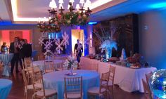 This room is a vision in blue with uplighting and holiday decor from Dallas Light and Sound.