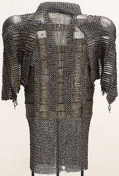 Persian zirh gomlak also:(zirah baktar/bagtar), a mail and plate shirt,  someone mistakenly put a pair of dizcek (cuisse or knee and thigh armor) on the shoulders. This is an example of how museums often know nothing about the items they are in charge of. The museum was notified and they have relabeled the description and it is now being displayed in the correct manner. Los Angeles County Museum of Art.
