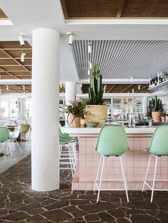 "White walls and pastel furnishings create a ""sun-drenched"" aesthetic inside Burleigh Heads Pavilion, which Alexander & Co has converted into two eateries. Sitges, Lazy Susan, Wabi Sabi, Hotel Boheme, Restaurants, House And Home Magazine, Design Awards, Gold Coast, White Walls"