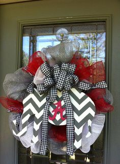 Grey, white, red deco mesh with houndstooth bow and hand painted wooden chevron elephant.
