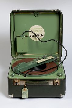A 1940s - 1950s Portable Dictaphone made by EMI - the Emidicta. Recordings would be made magnetically on a flat disk of magnetic material