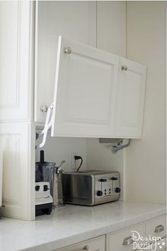 In this conversion, you will love all the creative hidden kitchen storage solutions . - In this conversion, you will love all the creative Hidden Kitchen Storage solutions! Kitchen Storage Solutions, Diy Kitchen Storage, Home Decor Kitchen, New Kitchen, Smart Storage, Kitchen Organization, Organized Kitchen, Hidden Storage, Kitchen Small