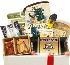 Alaska wild berry tea, Crackers, Salmon pillow pack, Oven mitt, Kitchen towel, Coasters, Alaska magnetic clip and Moose salt & pepper shaker.